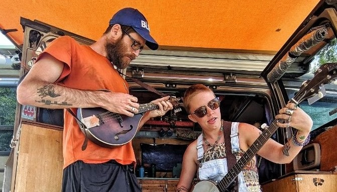 John Acoustic Bridge Founder playing mandolin while wife plays banjo